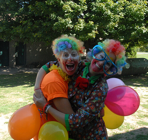 two girls dressed as clowns